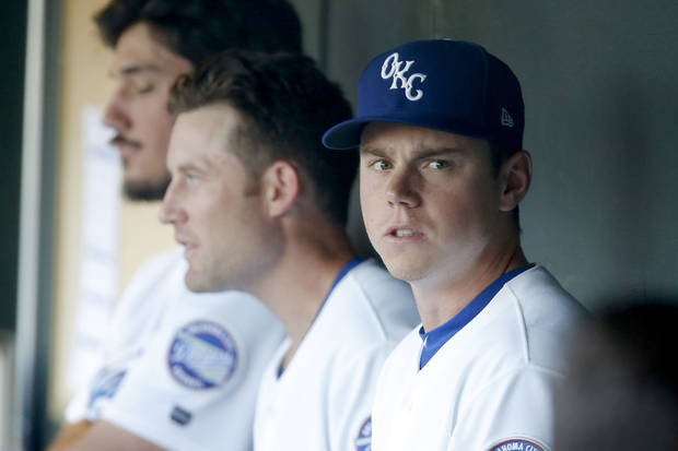 Oklahoma City's Will Smith (10) watches from the dugout before a minor league baseball game between the Oklahoma City Dodgers and the New Orleans Baby Cakes at Chickasaw Bricktown Ballpark in Oklahoma City, Thursday, June 27, 2019. [Bryan Terry/The Oklahoman]