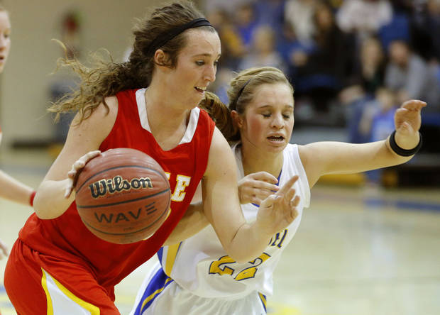 photo - Dale&#039;s Danielle Dockrey goes past Bethel&#039;s Genna Robinson during their girls high school basketball game at Bethel High School in Shawnee, Okla., Friday, Feb. 1, 2013. Photo by Bryan Terry, The Oklahoman