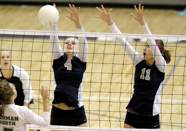 photo - GIRLS HIGH SCHOOL VOLLEYBALL: Edmond North's Maggie Benson, left, and Sydnie Gabbard go for the block against Norman North's Grace Lamar during a volleyball match in Edmond, Okla., Tuesday, Sept. 27, 2011. Photo by Bryan Terry, The Oklahoman ORG XMIT: KOD