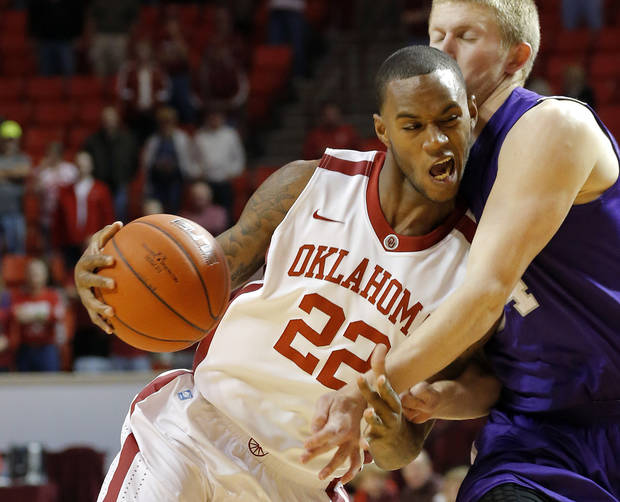 photo - Oklahoma's Amath M'Baye (22) tries to get around Stephen F. Austin's Jacob Parker (34) during a college basketball game between the University of Oklahoma (OU) and Stephen F. Austin University at the Lloyd Noble Center in Norman, Okla., Tuesday, Dec. 18, 2012. Photo by Bryan Terry, The Oklahoman