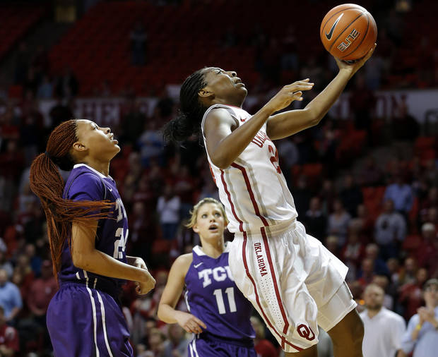 photo - OU: Oklahoma's Sharane Campbell (24) goes to the basket past TCU's Natalie Ventress (24) and Kamy Cole (11) during a women's college basketball game between the University of Oklahoma and TCU at the Lloyd Noble Center in Norman, Okla., Wednesday, Jan. 30, 2013. Photo by Bryan Terry, The OklahomanOU: