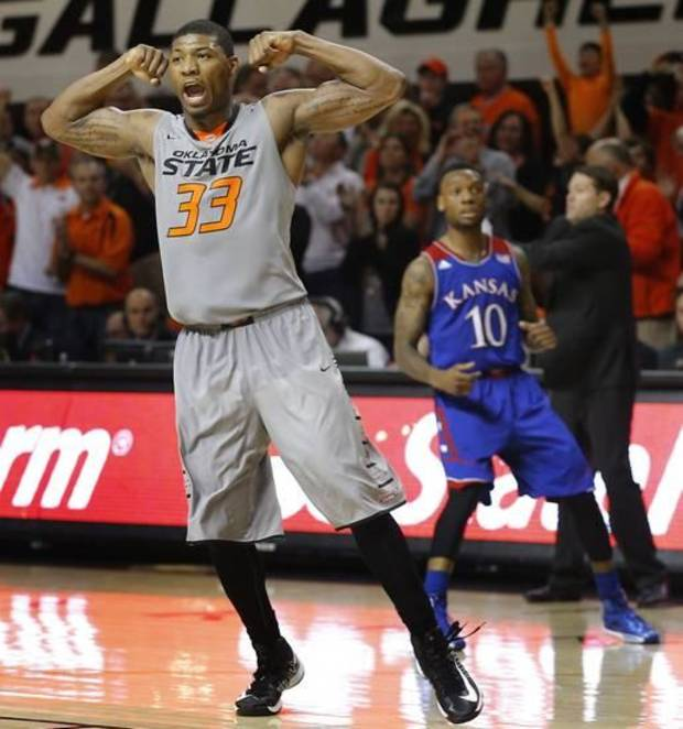 Oklahoma State's Marcus Smart (33) celebrates in front of Kansas' Naadir Tharpe (10) during an NCAA college basketball game between Oklahoma State University (OSU) and the University of Kansas at Gallagher-Iba Arena in Stillwater, Okla., Saturday, March 1, 2014. Oklahoma State won 72-65. Photo by Bryan Terry, The Oklahoman
