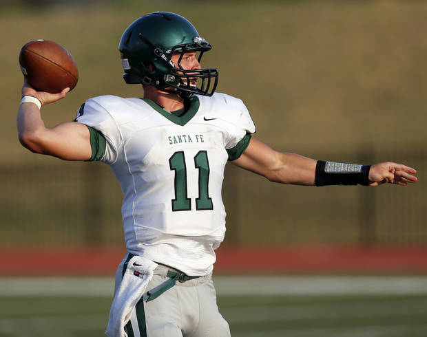 photo - Edmond Santa Fe&#039;s Justice Hansen (11) passes during a high school football scrimmage at Moore Stadium between Edmond Santa Fe and Norman North in Moore, Okla., Thursday, Aug. 16, 2012. Photo by Nate Billings, The Oklahoman