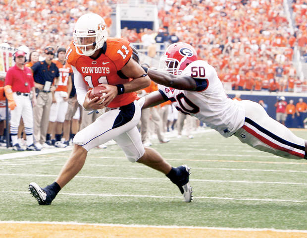 photo - Oklahoma State has one win over an SEC opponent this season, in the opener against Georgia in September 2009. PHOTO BY SARAH PHIPPS, THE OKLAHOMAN