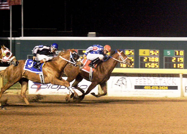 photo - Del Shake, right, won the Oklahoma Futurity, her second win at Remington Park. Photo by Dustin Orona Photography, Remington Park