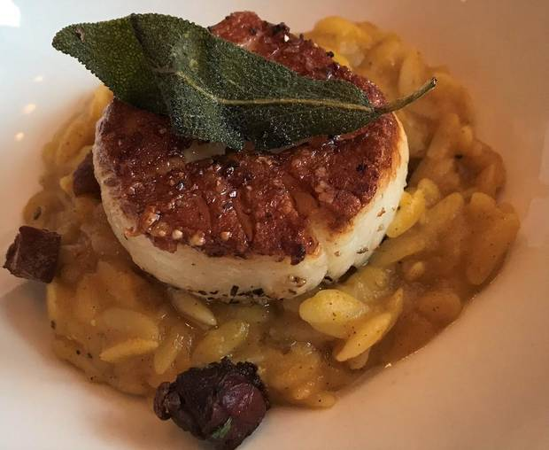 Seared scallop over butternut squash risotto from Patrono. [Dave Cathey/The Oklahoman]