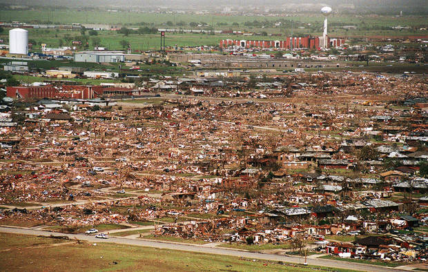 photo - MAY 3, 1999 TORNADO: Tornado damage: Aerial view of Moore looking northeast from near 12th street northeast.  First Baptist Church is at top right.