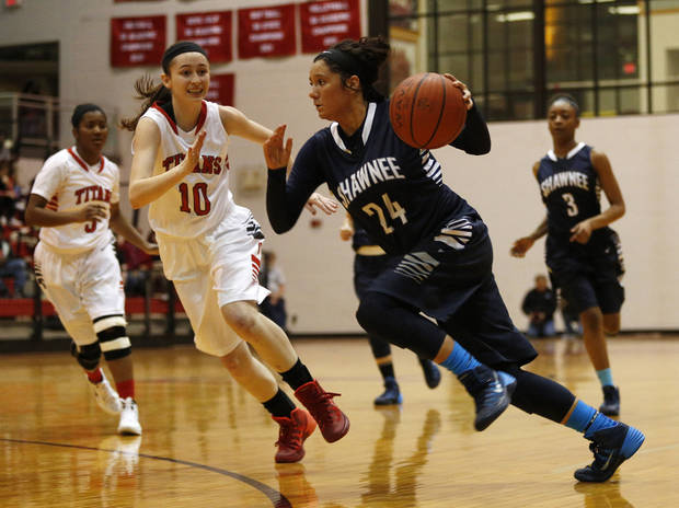 photo - Shawnee's Bailey Taylor (24) drives a ball against Carl Albert's Lanie Batten-Goodman (10) during a high school basketball game in Midwest City, Tuesday, Jan. 28, 2014.  Photo by Garett Fisbeck, For The Oklahoman