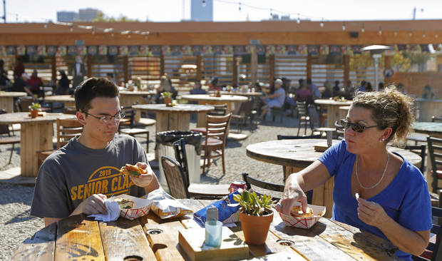 Gavin Barrett, 17, and his mother Debbie Barrett enjoy lunch at the Bleu Garten food truck park in Oklahoma City, Saturday, October 25, 2014. Photo by Bryan Terry, The Oklahoman