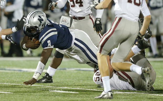 photo - Edmond North's Michael Farmer leaps for more yards against Edmond Memorial during a high school football playoff game at Wantland Stadium in Edmond, Okla., Thursday, Nov. 8, 2012. Photo by Bryan Terry, The Oklahoman ORG XMIT: KOD