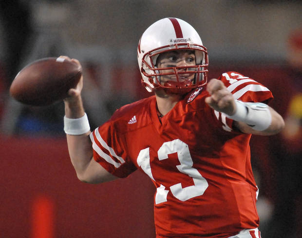 photo - University of Nebraska quarterback Zac Taylor throws against Colorado in their college football game in Lincoln, Neb., Friday, Nov. 24, 2006.  Zac Taylor threw two touchdown passes on a record-setting day and No. 23 Nebraska, already bound for the Big 12 championship game, pulled out all its tricks against Colorado in a 37-14 victory Friday.(AP Photo/Dave Weaver) ORG XMIT: NENH114