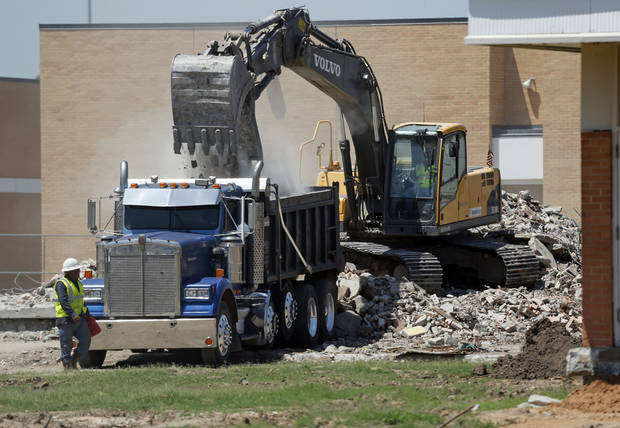 Demolition is underway on buildings at Norman High School on Tuesday. PHOTO BY STEVE SISNEY, THE OKLAHOMAN.
