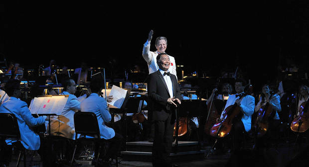 "photo - Surrounded by members of the Oklahoma City Philharmonic, conductor Jack Everly heralds George Takei, narrator of the ""Sci-Fi Spectacular"" show that the philharmonic performed last weekend. PHOTO PROVIDED BY WENDY MUTZ PHOTOGRAPHY. <strong>WENDYMUTZ - WENDY MUTZ PHOTOGRAPHY</strong>"