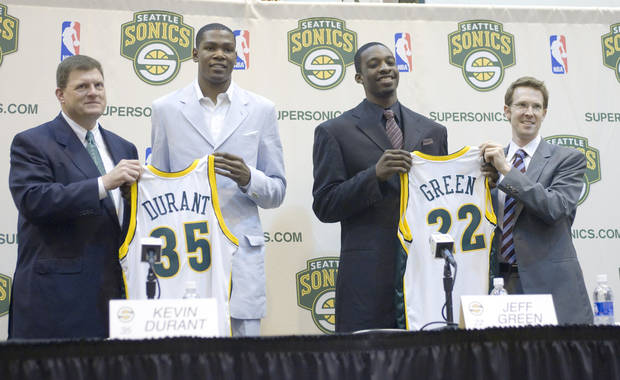 photo - NBA basketball team Seattle SuperSonics draft pick Kevin Durant, second from left, and Jeff Green, second from right, the rights to whom the Sonics acquired in a trade with the Boston Celtics for Ray Allen, are introduced to the news media at the Sonics' practice center in Seattle on Friday, June 29, 2007. At left is owner, chairman Clay Bennett and at right is general manager Sam Presti. (AP Photo/John Froschauer)