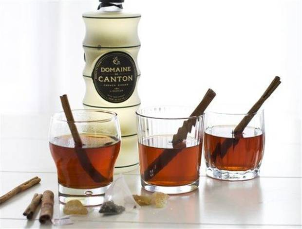 photo - In this image taken on Monday, Oct. 29, 2012, Canton, a French ginger liqueur, served in cinnamon tea is shown in Concord, N.H. (AP Photo/Matthew Mead)