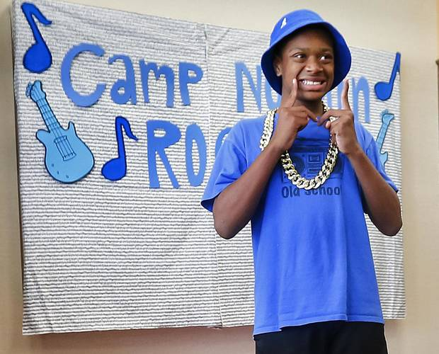 photo - Jeremy Eaves poses for a photo during the Camp Noggin talent show  at Youth and Family Services in El Reno, Okla. on Thursday, June 5, 2014 .  The camp that is held for children with autism to have a place to take part in summer activities. Photo by Chris Landsberger, The Oklahoman   CHRIS LANDSBERGER - CHRIS LANDSBERGER
