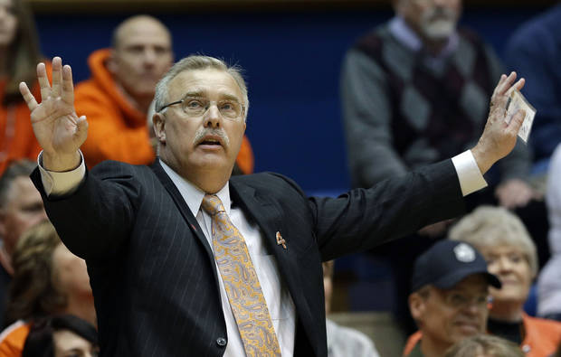 photo - Oklahoma State coach Jim Littell reacts against DePaul during the second half of a first-round game in the women's NCAA college basketball tournament in Durham, N.C., Sunday, March 24, 2013. Oklahoma State won 73-56. (AP Photo/Gerry Broome) ORG XMIT: NCGB122