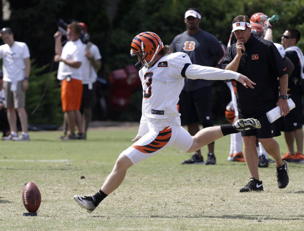 photo - Cincinnati Bengals kicker Quinn Sharp (3) kicks off during practice at the NFL football team's training camp, Monday, July 29, 2013, in Cincinnati.  (AP Photo/Al Behrman) ORG XMIT: OHAB101