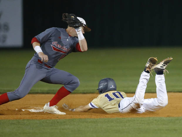 Heritage Hall's Colby Lewis steals second as Verdigris's Kade Keith tries to place a tag in the first inning during the high school baseball playoff game between Heritage Hall and Verdigris at Edmond Santa Fe High School in Edmond, Okla., Thursday, May 10, 2018. Photo by Sarah Phipps, The Oklahoman