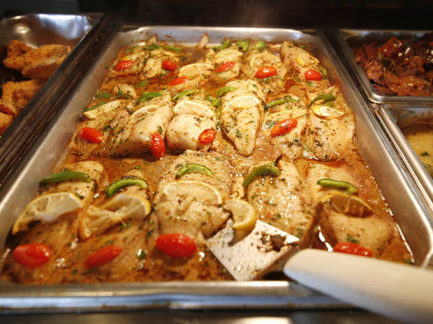 photo - Baked tilapia at Capers Mediterranean Buffet and Bistro. <strong>STEVE GOOCH - THE OKLAHOMAN</strong>