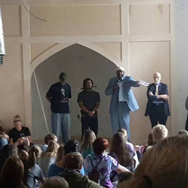 Three leaders and members of Masjid Mu'min, Michael Gipson, Ismail Calhoun and  Imam Arif Abdullah, speak to participants of the 2016 Interfaith Youth Tour as the Rev. William Tabbernee, at right, looks on. [Photo by Carla Hinton, The Oklahoman]