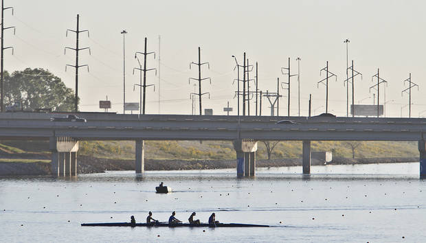 photo - Competitors are lit by the morning sun as they warm up before competing during the Oklahoma Regatta Festival at the Oklahoma River on Saturday, Oct. 1, 2011, in Oklahoma City, Okla. Photo by Chris Landsberger, The Oklahoman Archives
