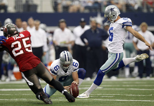 photo - Dallas Cowboys kicker Dan Bailey (5) boots a field goal as Chris Jones (6) holds against the Tampa Bay Buccaneers during the first half of an NFL football game on, Sunday, Sept. 23, 2012, in Arlington, Texas. (AP Photo/LM Otero)