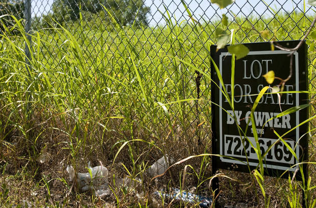 "photo - A ""For Sale"" sign sits by the fence along side ""Ristricted Area"" signs at the Superfund site on NW 10th street in Oklahoma City, Okla on Tuesday June 20, 2010. Photo by Mitchell Alcala, The Oklahoman  ORG XMIT: KOD"