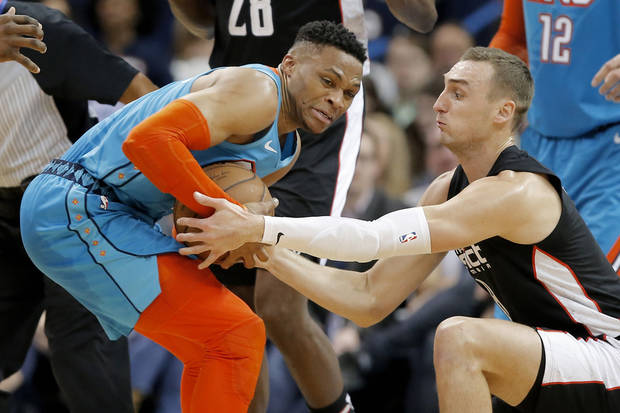Oklahoma City's Russell Westbrook (0) fights for the ball with Washington's Sam Dekker (8) during an NBA basketball game between the Oklahoma City Thunder and the Washington Wizards at Chesapeake Energy Arena in Oklahoma City, Sunday, Jan. 6, 2019. Photo by Bryan Terry, The Oklahoman