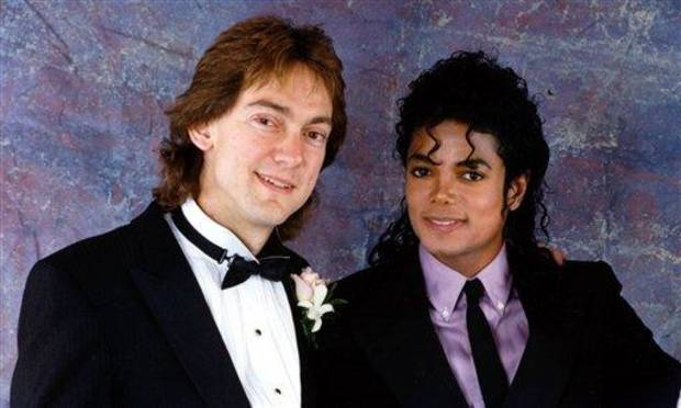 photo - FILE - In this 1987 file photo originally released by John Branca, attorney John Branca, left, and Michael Jackson are shown at Branca's wedding in Beverly Hills, Calif.  Branca, and his co-executor, John McClain, have been successfully pursuing projects to pay off a mountain of debt left by the superstar, to assure the financial future of his three children and to guarantee that Jackson's music will live forever. (AP Photo/ Courtesy of John Branca, File) ** NO SALES **