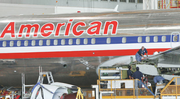 photo - In this 2005 photo, American Airlines workers are shown at a maintenance facility near Alliance Airport in Fort Worth, Texas. American Airlines performs 85 percent of its maintenance work in-house.Ap PHOTO