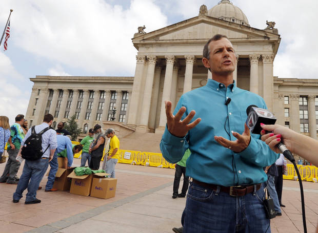 photo - Chip Paul, chairman Oklahomans for Health, speaks with the media during a medical marijuana rally at the State Capitol on May 28, 2014 in Oklahoma City, Okla. This is formal launch of a signature drive to get a medical marijuana measure on a statewide ballot.  (AP PHOTO/The Oklahoman, Steve Sisney)