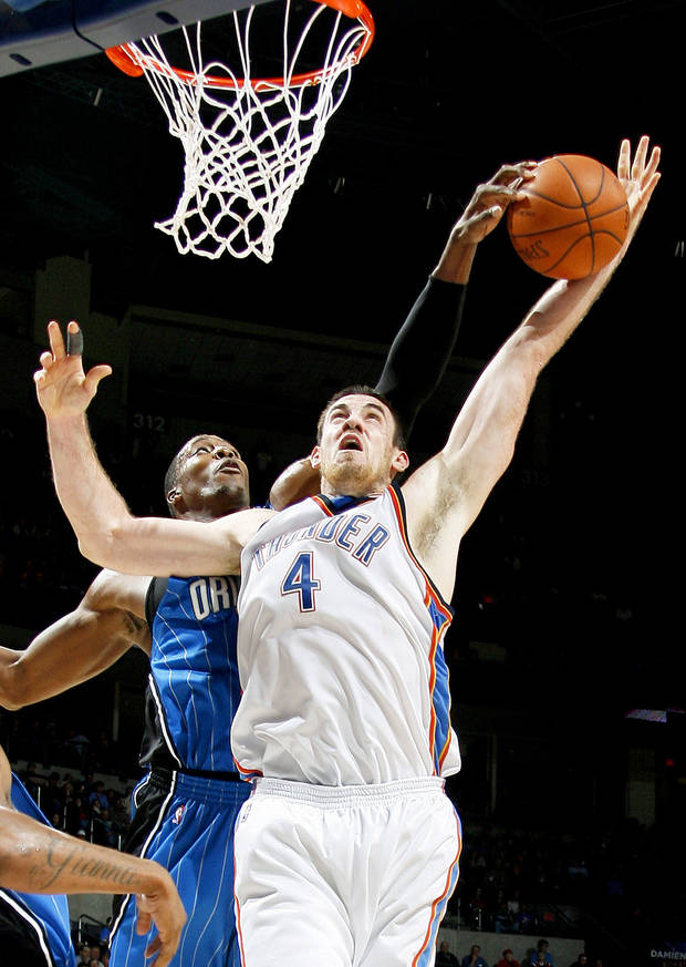 photo - Orlando's Dwight Howard blocks the shot of Oklahoma City's Nick Collison during Wednesday's game. The Thunder is shooting a league-worst 40 percent from the field. PHOTO BY BRYAN TERRY, THE OKLAHOMAN