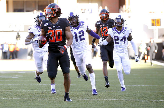 Oklahoma State's Chuba Hubbard (30) rushes for a 92-yard touchdown in the third quarter during the college football game between the Oklahoma State University Cowboys and the TCU Horned Frogs at Boone Pickens Stadium in Stillwater, Okla., Saturday, Nov. 2, 2019. OSU won 34-27. [Sarah Phipps/The Oklahoman]