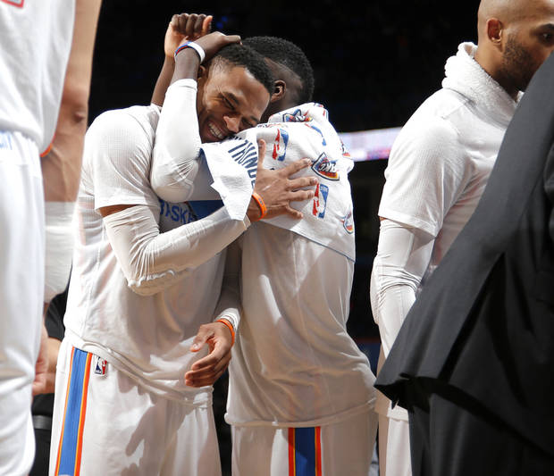 Russell Westbrook hugs Victor Oladipo during celebrations of Westbrook's 41st triple double of the season, which Tuesday night tied Oscar Robertson's single-season NBA record. (Photo by Bryan Terry)