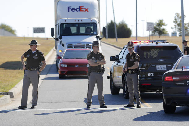 In this file photo, Oklahoma Highway Patrol troopers block traffic at a checkpoint Nov. 15 after a fatal shooting at Will Rogers World Airport. Photo By Steve Gooch, The Oklahoman