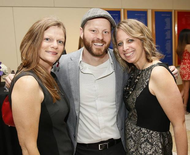 "From left, Tava Maloy Sofsky, director of the Oklahoma Film + Music Office, Kyle Roberts, the filmmaker behind the 2019 deadCenter Film Festival selection ""Trolls Stop Motion,"" and Sarah Roberts, Roberts' wife, pose for a photo during the 2017 Oklahoma Creativity Ambassadors Gala at the National Cowboy & Western Heritage Museum in Oklahoma City, Monday, April 3, 2017. The Oklahoma Film + Music Office has been named one of deadCenter's 2019 Oklahoma Film Icon Award winners for its work investing in film in Oklahoma. [Photo by Nate Billings/The Oklahoman Archives]"