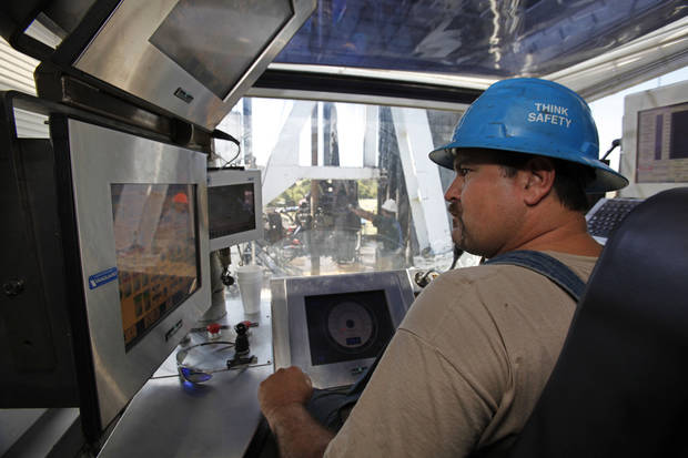photo - H&P Driller Greg Sullivan controlls the drilling of a Devon natural gas well near Geary, Tuesday, September 1, 2010.        Photo by David McDaniel, The Oklahoman