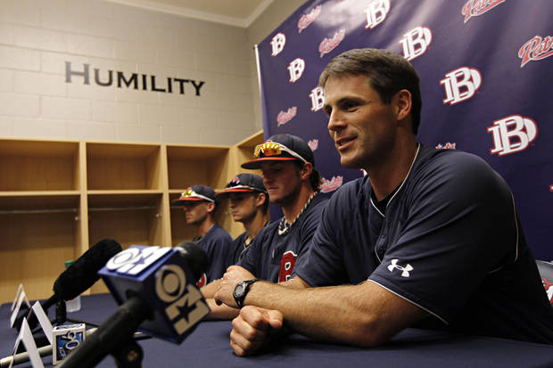 photo - Dallas Baptist coach Dan Heefner, right, holds a press conference Wednesday, June 8, 2011 in Dallas. (G.J. McCarthy/The Dallas Morning News)