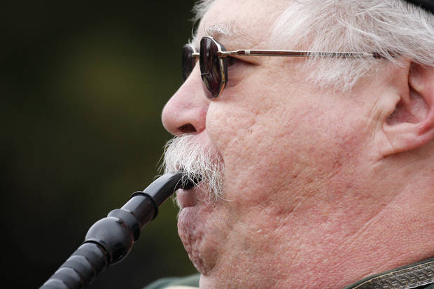 photo - Paul Shell plays bagpipes for the Pipes and Drums of the Highlanders of Oklahoma City at the Iron Thistle Scottish Heritage Festival and Highland Games at the Kirkpatrick Family Farm in Yukon in 2009. Photo by Doug Hoke, Oklahoman Archive