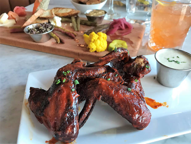 Chile Rojo Wings and a Charcuterie board from The Red Rooster. [Dave Cathey/The Oklahoman]