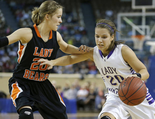 photo - Okarche's Morgan Vogt tries to get past Cheyenne's Taylor Swisher during the Class A girls state championship game between Okarche and Cheyenne/Reydon in the State Fair Arena at State Fair Park in Oklahoma City, Saturday, March 2, 2013. Photo by Bryan Terry, The Oklahoman