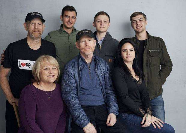 "Steve (Woody) Culleton, from left, Bryson Groh, Zach Boston, Brandon Burke, Michelle John, from bottom right, director Ron Howard and Carly Jean Ingersoll pose for a portrait to promote the film ""Rebuilding Paradise"" at the Music Lodge during the Sundance Film Festival on Friday, Jan. 24, 2020, in Park City, Utah. [Photo by Taylor Jewell/Invision/AP]"