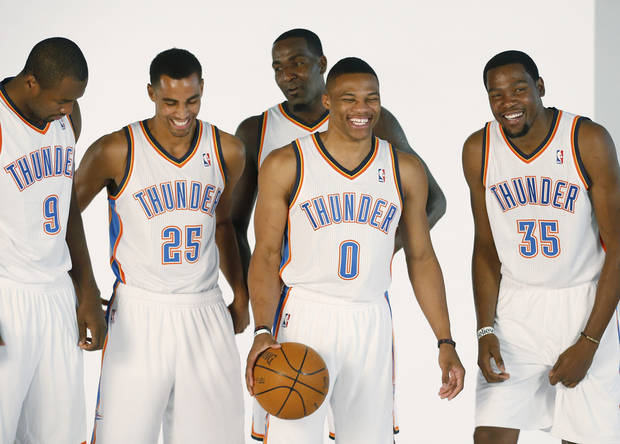 photo - Oklahoma City Thunder players, from left, Serge Ibaka, Thabo Sefolosha, Kendrick Perkins, Russell Westbrook and Kevin Durant, laugh as they prepare to have a group photo taken during NBA basketball media day  in Oklahoma City, Friday, Sept. 27, 2013. (AP Photo/Sue Ogrocki)