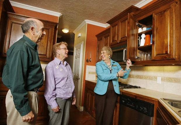 photo - Realtor Pat Oltermann, right, showing the kitchen to Leroy and Lois Hinderliter, Mustang, in a home for sale in Oklahoma City.  File photo by Paul B. Southerland, The Oklahoman.