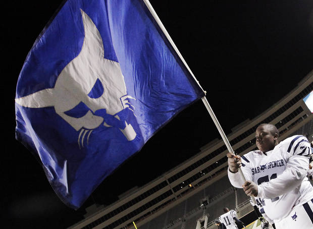 photo - Star Spencer's Marquise Vardiman (71) waves the flag of the Bobcats after the Class 4A high school football state championship game between Star Spencer and Douglass at Boone Pickens Stadium in Stillwater, Okla., Saturday, December 5, 2009. Star Spencer won, 34-21. Photo by Nate Billings, The Oklahoman ORG XMIT: KOD