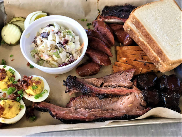 Fatty's Kitchen Sink includes brisket, rib, sausage, smoked chicken and burnt ends.