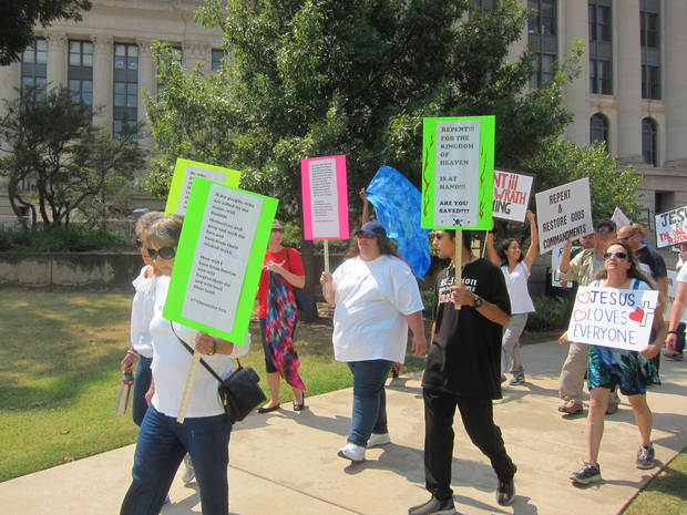 group walks around the State Capitol as part of a prayer gathering Saturday to show support for the Ten Commandments monument on capitol grounds. [Photo by Carla Hinton, The Oklahoman]