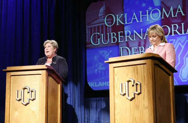 photo - Oklahoma Democratic Lt. Gov. Jari Askins, left, answers a question from a panel member while U.S. Rep. Mary Fallin, R-Okla., listens during a gubernatorial debate on the campus of the University of Central Oklahoma in Edmond, Okla., on Tuesday, Oct. 19, 2010. (AP Photo/Alonzo Adams)
