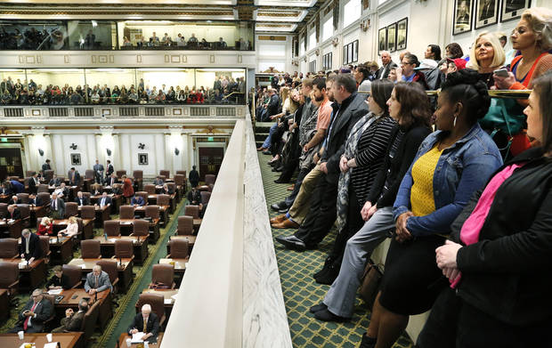 Every seat in the gallery was occupied and those guests and visitors who were unable to secure a chair stood in the walkway from end to end to watch and hear legislators debate. Photo by Jim Beckel, The Oklahoman